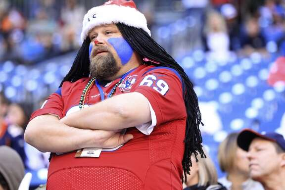 A fan reacts to the Texans' 37-13 loss to the Broncos.