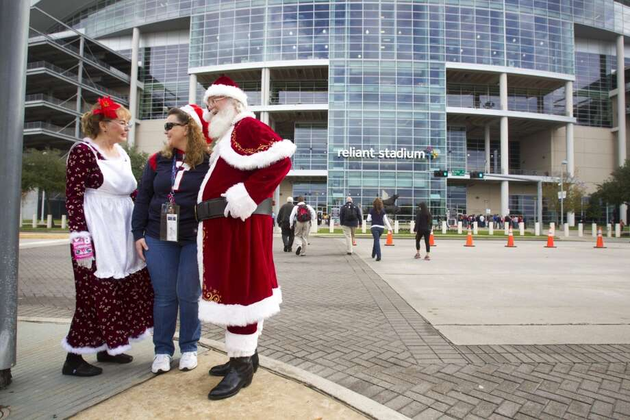 Fans get in the Christmas spirit before the Texans' game against the Broncos. Photo: Brett Coomer, Houston Chronicle