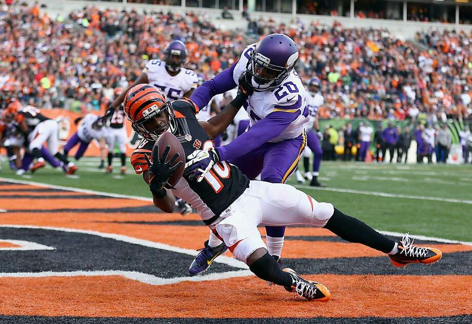 Cincinnati's A.J. Green hauls in an Andy Dalton TD pass in front of Minnesota's Chris Cook. Photo: Andy Lyons, Getty Images