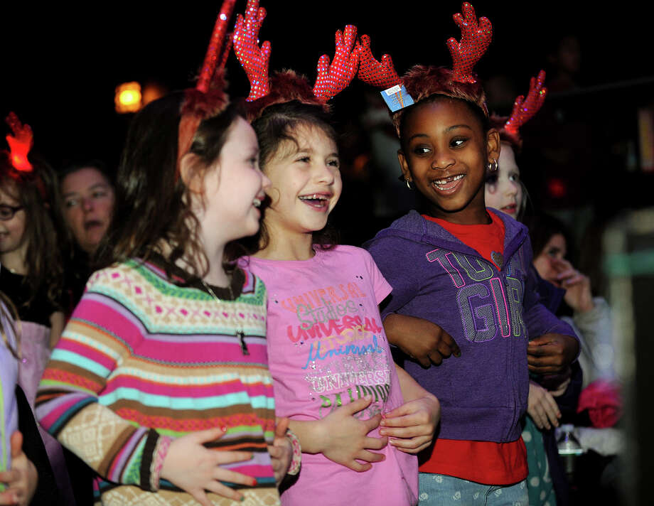 From left; Madison Wren, 6, of Easton, Sarah Ballas, 6 of Easton, and Rihanna Romeus, 6, of Bridgeport, enjoy themselves in the front row of the Santa's Crazy Christmas Special show at The Bijou Theater in Bridgeport, Conn. on Sunday, December 22, 2013. Photo: Brian A. Pounds / Connecticut Post