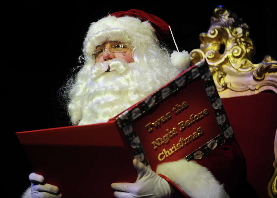 "Santa Claus reads ""Twas the Night Before Christmas"" to a full house of children and their parents during the Santa's Crazy Christmas Special show at The Bijou Theater in Bridgeport, Conn. on Sunday, December 22, 2013. Photo: Brian A. Pounds / Connecticut Post"