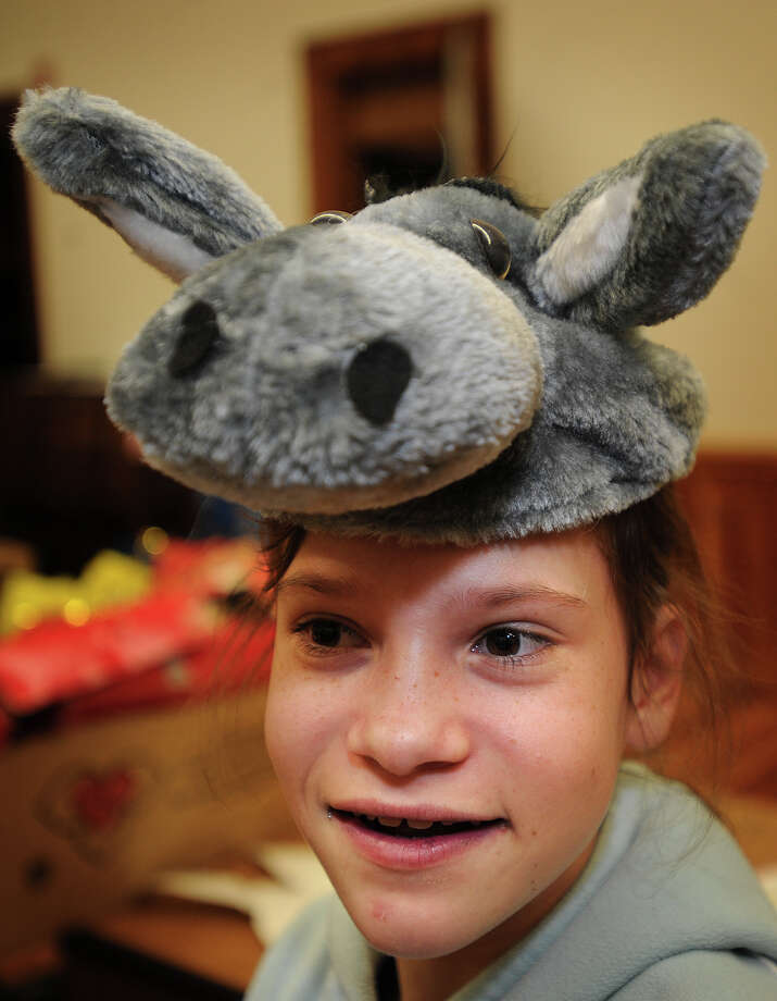 Lillia Downing, 11, of Milford, puts on a donkey hat as she waits to participate in a Living Nativity scene at Mary Taylor Memorial United Methodist Church in Milford, Conn. on Sunday, December 22, 2013. Photo: Brian A. Pounds / Connecticut Post