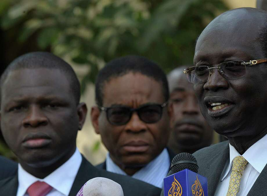 South Sudan official Barnaba Mariel (right), and Nigeria's Nurudeen Mohammed (left) speak to the press. Photo: AFP / Getty Images / AFP
