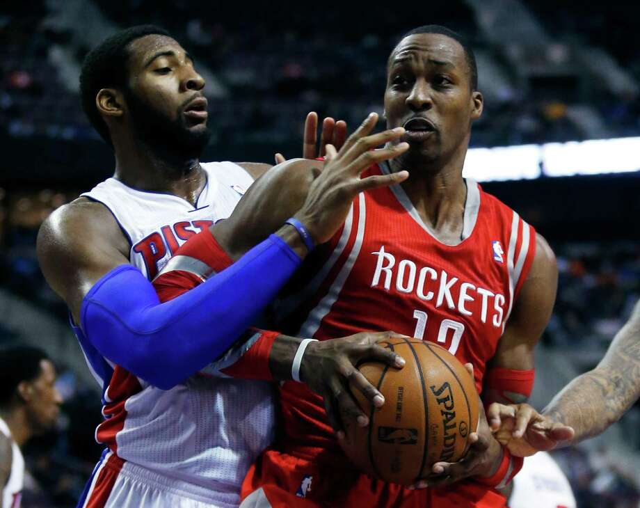 Dwight Howard brushed aside the efforts of Andre Drummond, left, and other Pistons to score a season-high 35 points Saturday night. Photo: Duane Burleson, FRE / FR38952 AP
