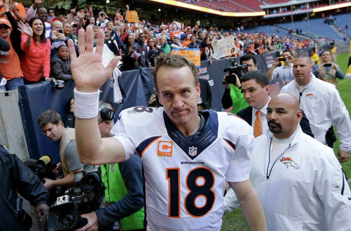Denver Broncos' Peyton Manning (18) waves to fans following an NFL football game against the Houston Texans, Sunday, Dec. 22, 2013, in Houston. Manning threw his 51st touchdown pass of the season to set a new NFL record. (AP Photo/David J. Phillip) ORG XMIT: HTT147