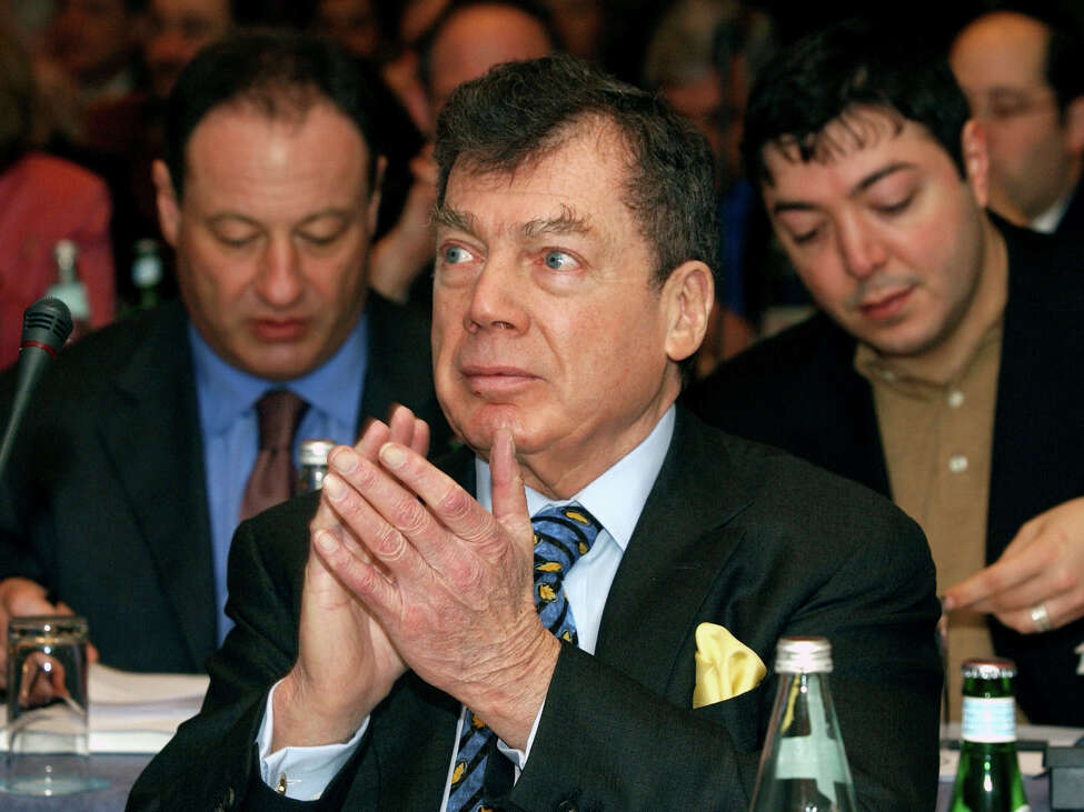 In this Jan. 10, 2005 file photo, World Jewish Congress President Edgar M. Bronfman applauds a speaker while attending the Plenary Assembly of the World Jewish Congress assembled in a hotel in Brussels.