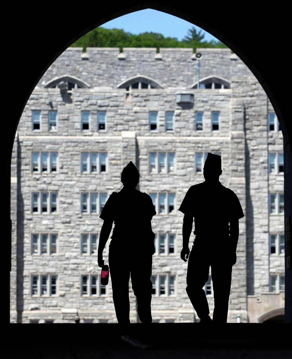 Cadets walk in a sally port at the U.S. Military Academy in West Point, N.Y., on Thursday, May 17, 2012. (AP Photo/Mike Groll)