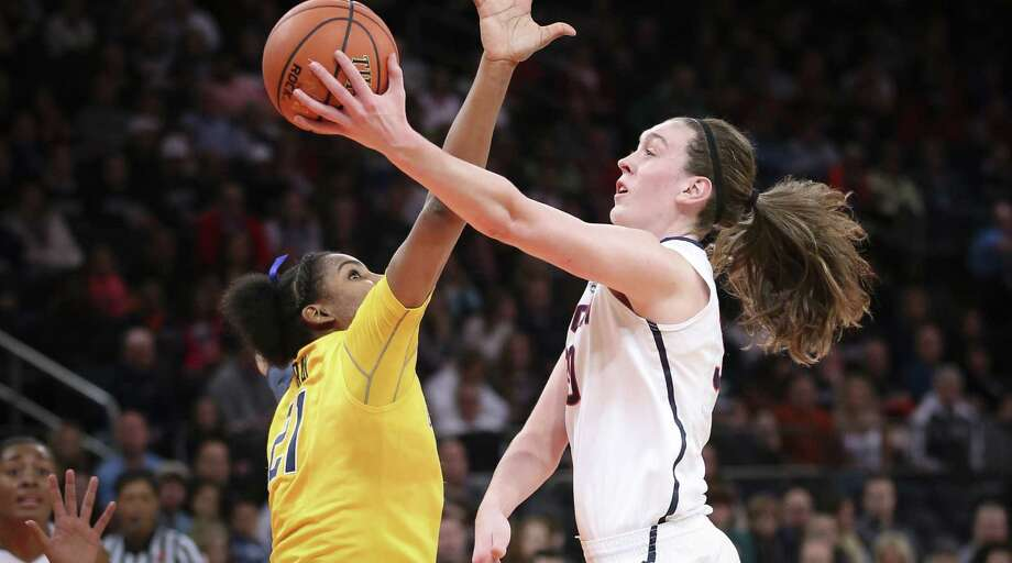 UConn's Breanna Stewart puts up a shot over Cal's Reshanda Gray. Stewart, a sophomore, matched her career-high with 29 points and added 10 rebounds. Photo: John Minchillo / Associated Press / FR170537 AP