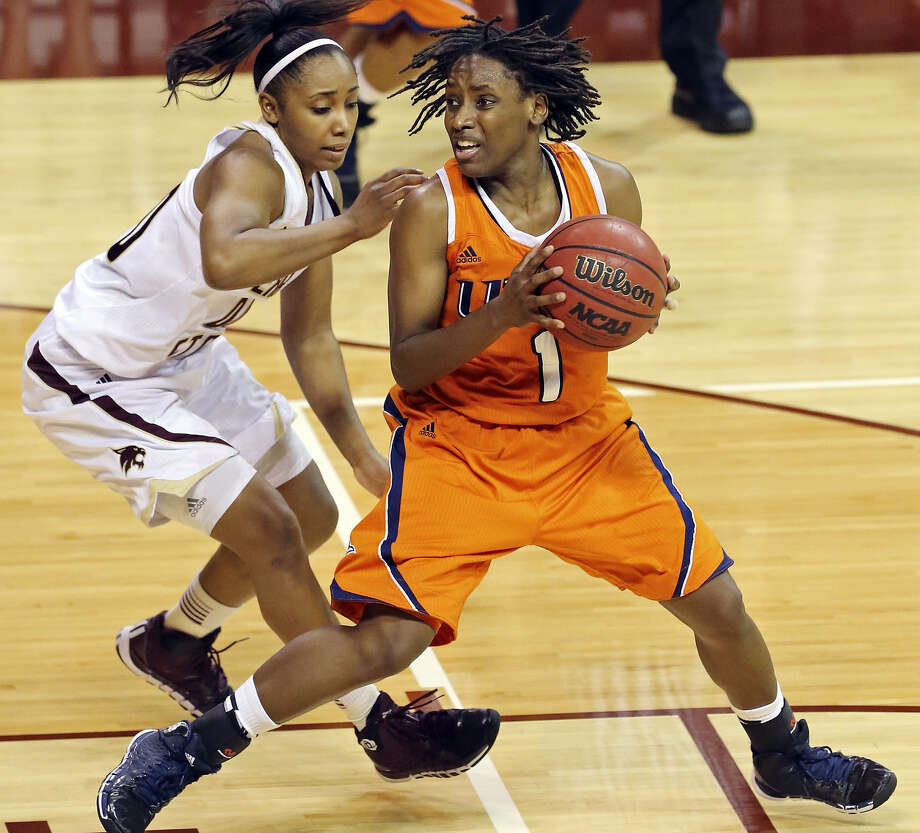 UTSA guard Miki Turner (right) tries to find an opening against Texas State's Kaylan Martin. Turner led the Roadrunners with 14 points, including their final two with 22.7 seconds left. Photo: Photos By Edward A. Ornelas / San Antonio Express-News / © 2013 San Antonio Express-News