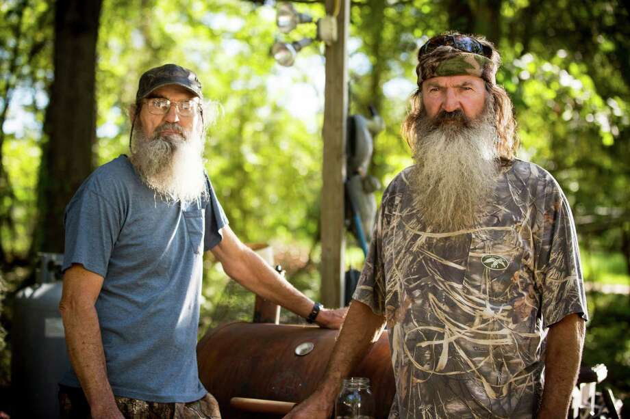 """This undated image released by A&E shows brothers Silas """"Uncle Si"""" Robertson, left, and Phil Robertson from the popular series """"Duck Dynasty."""" Phil Robertson was suspended last week for disparaging comments he made to GQ magazine about gay people. (AP Photo/A&E, Zach Dilgard) Photo: Zach Dilgard, HOEP / A&E"""