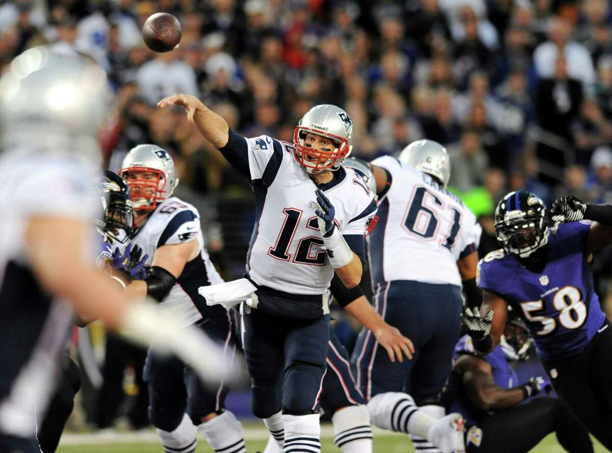 New England Patriots quarterback Tom Brady (12) throws to a receiver in the first half of an NFL football game against the Baltimore Ravens, Sunday, Dec. 22, 2013, in Baltimore. (AP Photo/Gail Burton) ORG XMIT: BAF102