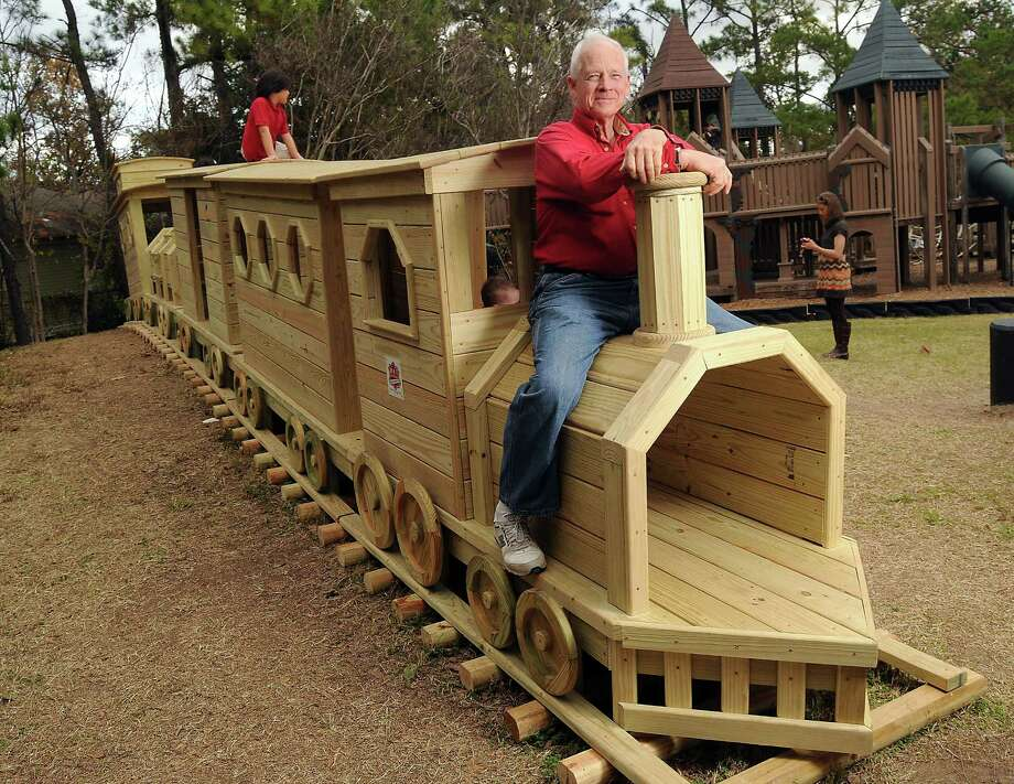 Paul Carr, a lifelong Heights resident, civic leader and former Houston firefighter, built a 40-foot-long wooden train for children to climb on in Donovan  Park. Photo: Dave Rossman, Freelance / © 2013 Dave Rossman