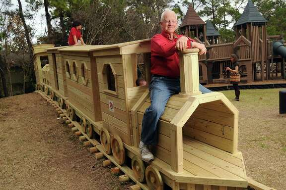 Paul Carr, a lifelong Heights resident, civic leader and former Houston firefighter, built a 40-foot-long wooden train for children to climb on in Donovan  Park.