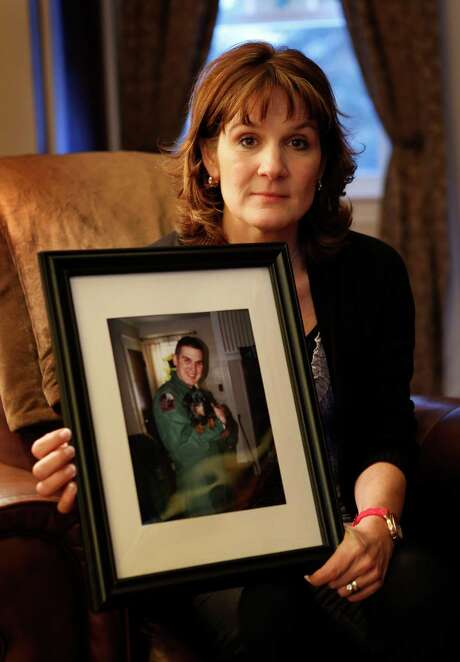 Hallie Twomey's son C.J. killed himslef 3½ years ago outside their Auburn, Maine, home. She is asking people to help scatter his ashes throughout the world. Photo: Robert F. Bukaty, STF / AP