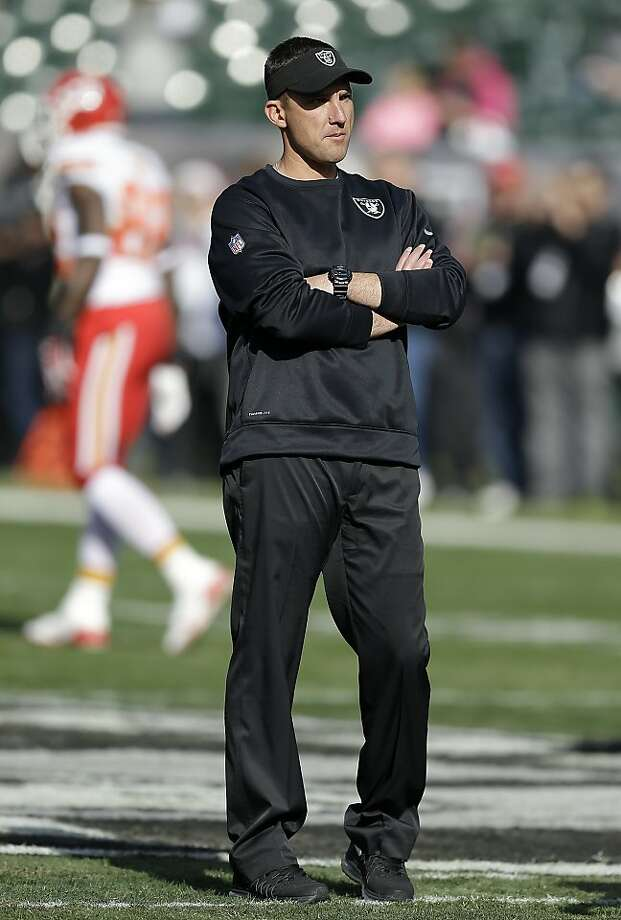 Oakland Raiders head coach Dennis Allen watches as players warm up before an NFL football game against the Kansas City Chiefs in Oakland, Calif., Sunday, Dec. 15, 2013. (AP Photo/Ben Margot) Photo: Ben Margot, Associated Press