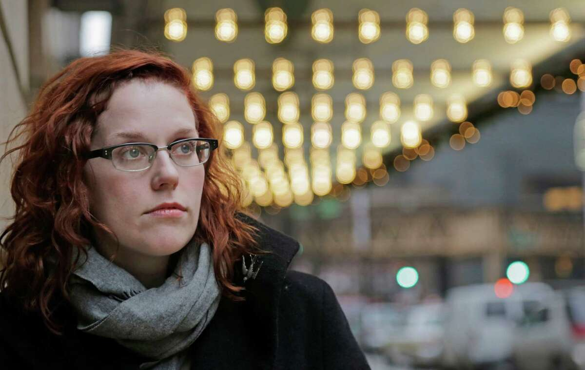 FILE - In this Dec. 3, 2013 photo, actor Adrienne Matzen poses in Chicago's theater district. Matzen, 29, who has been mostly uninsured since she turned 21, is now looking for a low monthly premium insurance plan on the federal website. High deductibles for health plans available on the Illinois insurance exchange may contribute to sticker shock when people start paying medical bills in 2014, if they have elected to pay for insurance under the Affordable Care Act. (AP Photo/M. Spencer Green, File) ORG XMIT: CX802