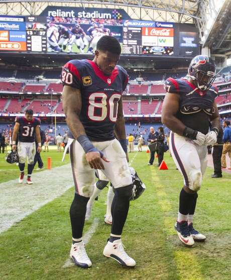Texans wide receiver Andre Johnson (80) and defensive tackle Terrell McClain walk off the field after a loss to the Denver Broncos at Reliant Stadium.