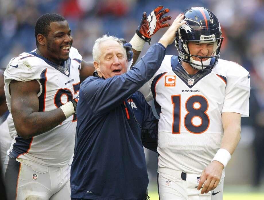 Broncos defensive end Malik Jackson (97) and head coach John Fox congratulate quarterback Peyton Manning after his record 51st touchdown pass of the season. Photo: Brett Coomer, Houston Chronicle