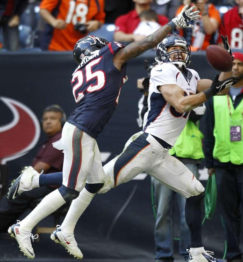Broncos wide receiver Eric Decker (87) beats Texans cornerback Kareem Jackson (25) to catch a 20-yard touchdown pass from Peyton Manning. Photo: Brett Coomer, Houston Chronicle