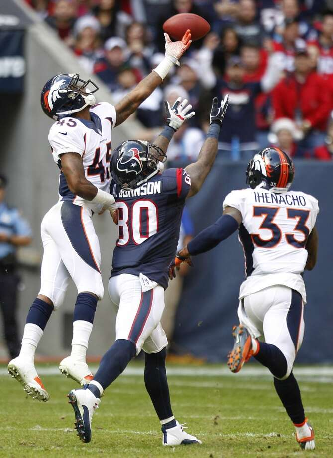 Broncos cornerback Dominique Rodgers-Cromartie (45) and strong safety Duke Ihenacho (33) defend an pass intended for Texans wide receiver Andre Johnson. Photo: Brett Coomer, Houston Chronicle