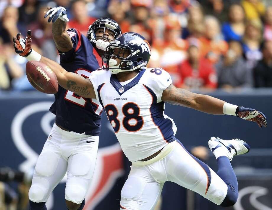 Texans cornerback Johnathan Joseph (24) knocks down a pass in the end zone intended for Broncos wide receiver Demaryius Thomas. Photo: Karen Warren, Houston Chronicle
