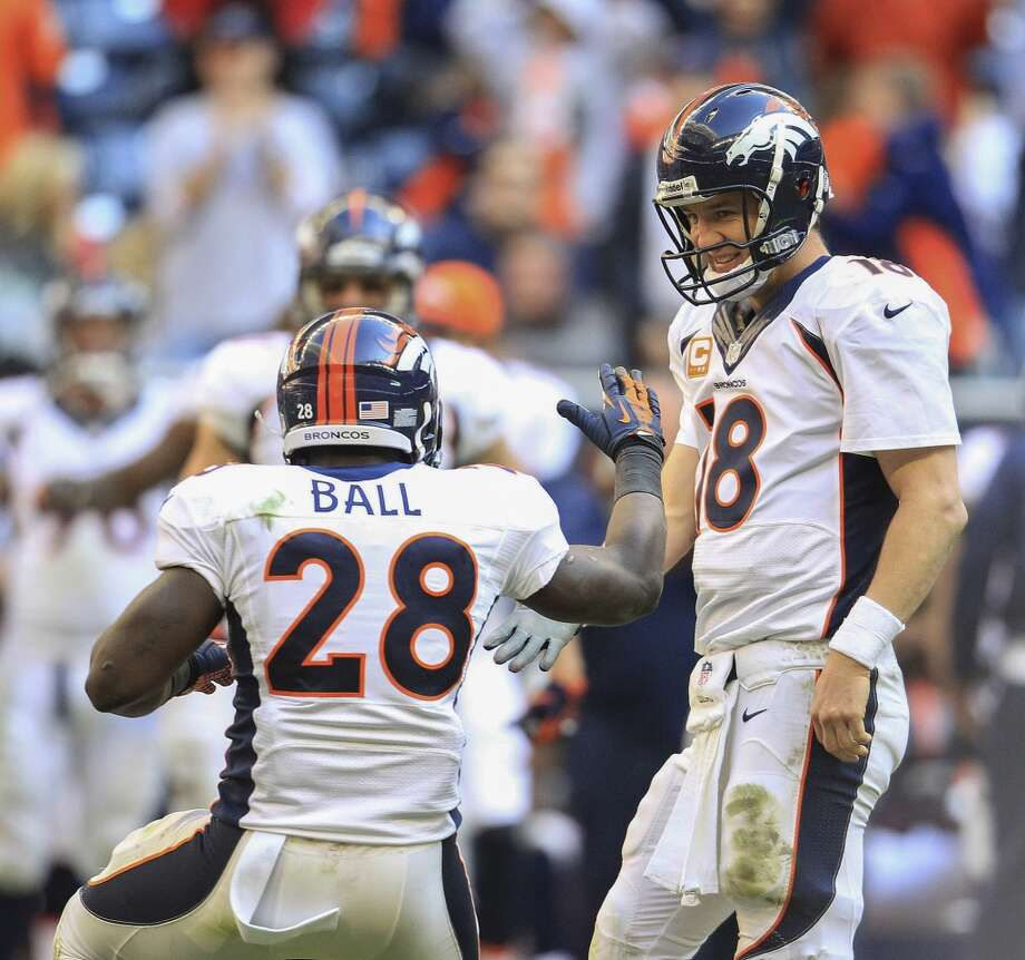 Broncos quarterback Peyton Manning is congratulated by Montee Ball after breaking the NFL record for touchdown passes in a season. Photo: Karen Warren, Houston Chronicle