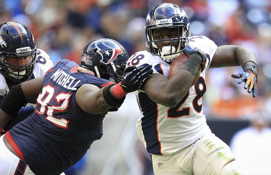 Broncos running back Montee Ball gains yardage on Texans nose tackle Earl Mitchell. Photo: Karen Warren, Houston Chronicle