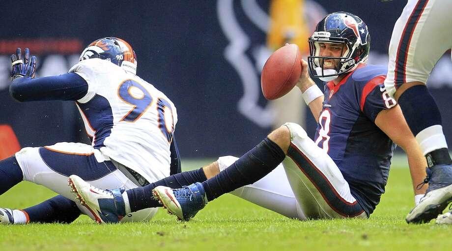 Texans quarterback Matt Schaub (8) reacts after being sacked by Broncos defensive end Shaun Phillips. Photo: Karen Warren, Houston Chronicle