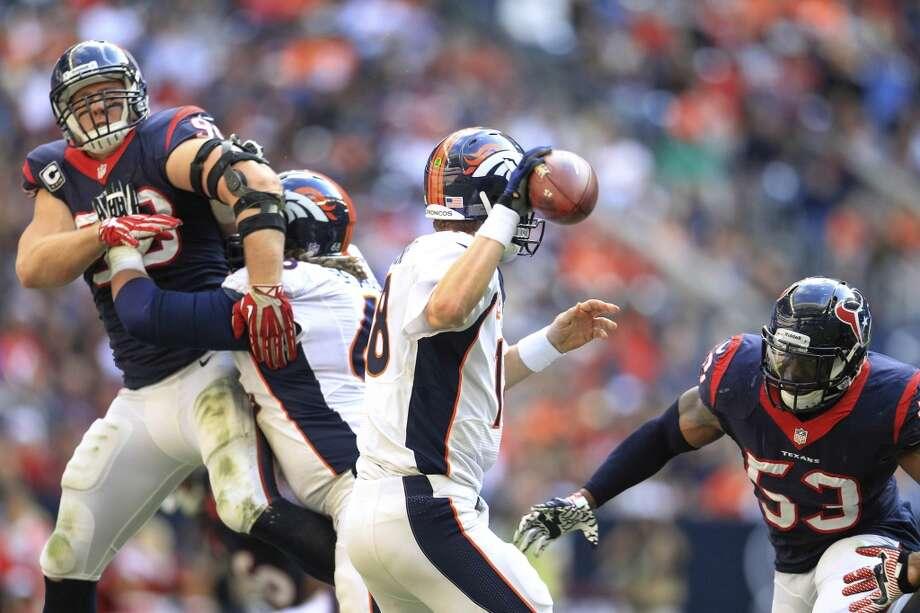 Texans defensive end J.J. Watt (99) and linebacker Joe Mays apply pressure to tries Broncos quarterback Peyton Manning. Photo: Karen Warren, Houston Chronicle
