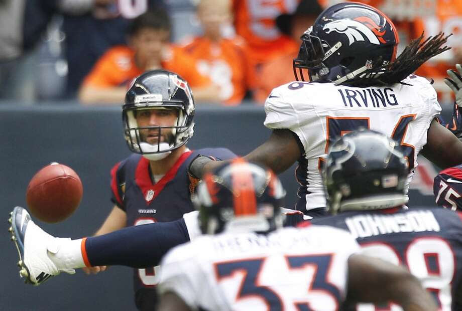 Broncos outside linebacker Nate Irving kicks a ball thrown by Texans quarterback Matt Schaub. Photo: Brett Coomer, Houston Chronicle