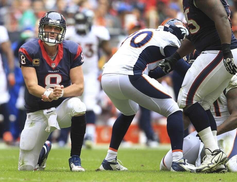Texans quarterback Matt Schaub gets up off the turf after a hit  during the second quarter. Photo: Karen Warren, Houston Chronicle