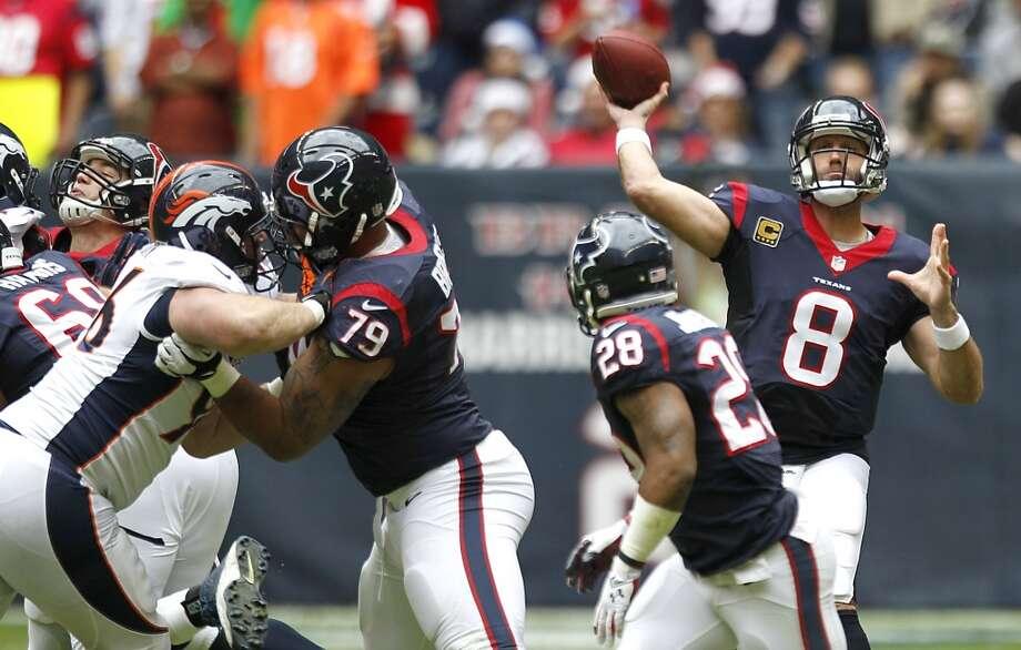 Texans quarterback Matt Schaub throws a pass against the Broncos. Photo: Brett Coomer, Houston Chronicle