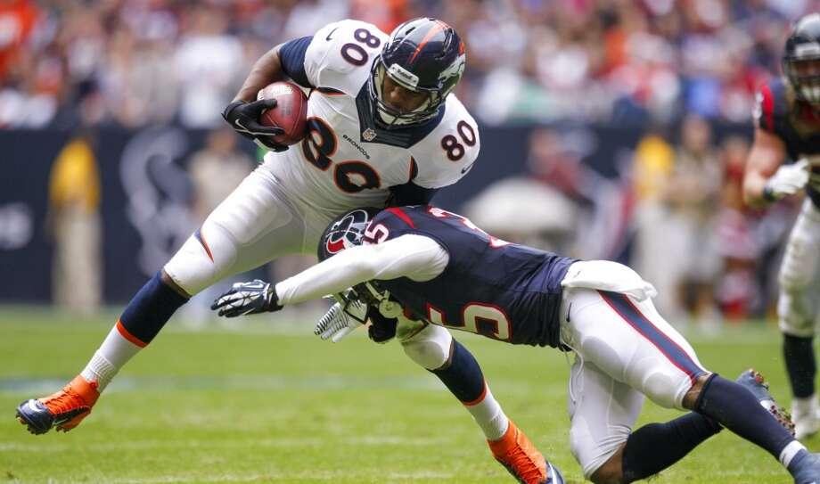 Texans safety Eddie Pleasant stops Broncos tight end Julius Thomas. Photo: Brett Coomer, Houston Chronicle