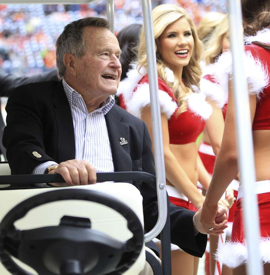 Former President George H.W. Bush sits in a golf cart on the sidelines before the game. Photo: Karen Warren, Houston Chronicle