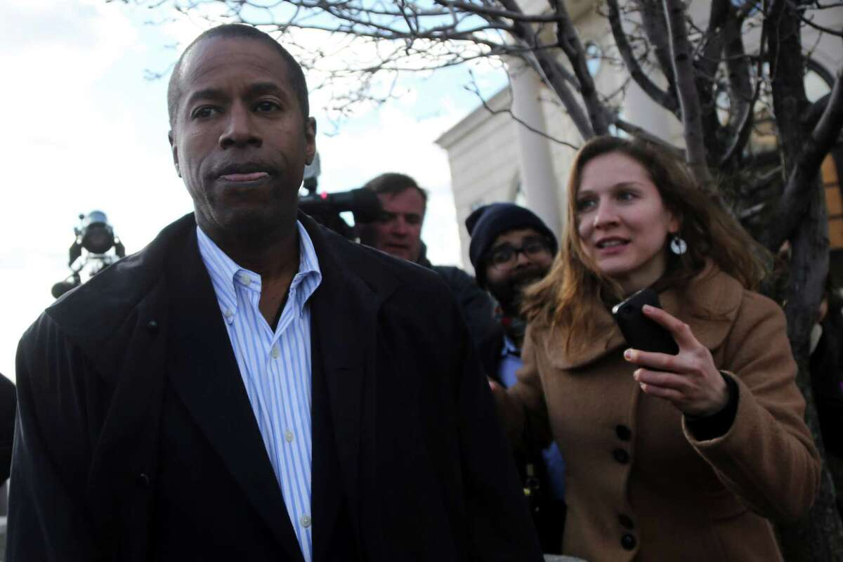 Sen. Malcolm Smith, D-Queens, leaves federal court, Tuesday, April 2, 2013 in White Plains, N.Y. The Democratic state lawmaker was arrested along with five other politicians Tuesday in an alleged plot to pay tens of thousands of dollars in bribes to GOP bosses to let him run for mayor of New York City as a Republican. (AP Photo/Mary Altaffer)
