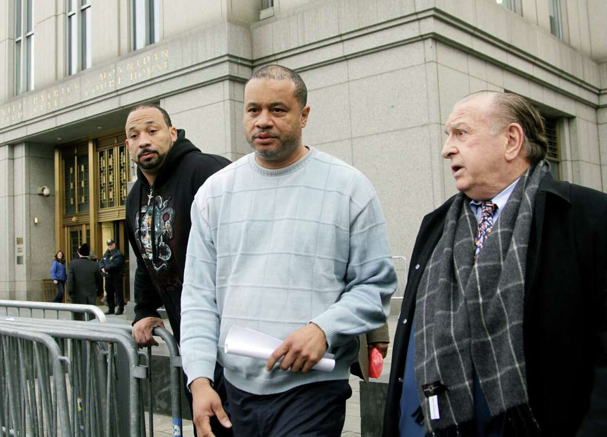 Eric Stevenson, a New York assemblyman, center, with lawyer Murray Richman, right, in New York, April 4, 2013. Stevenson was arrested Thursday on federal charges of accepting bribes and another lawmaker was forced to quit after a scheme to help developers open adult day care centers was uncovered. (John Marshall Mantel/The New York Times)