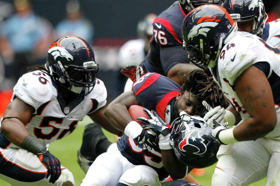 Broncos defensive tackle Terrance Knighton reveals one of the unfamiliar faces of the Texans offense -that of running back Deji Karim. A fourth-stringer at the start of the season, Karim had eight carries Sunday. Photo: Brett Coomer, Staff / © 2013  Houston Chronicle