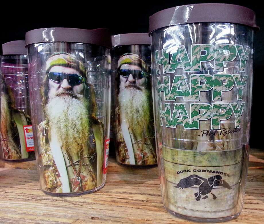 """Items showing the image of Phil Robertson and his catchphrase """"Happy, Happy, Happy"""" are displayed at the Duck Commander store. Photo: Matthew Hinton / Associated Press / FR170690 AP"""