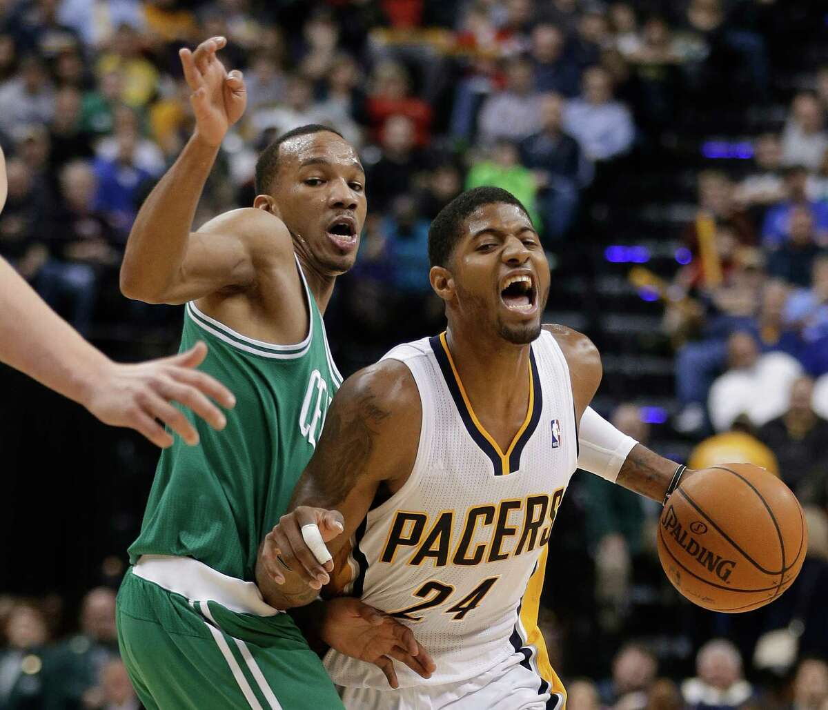 Indiana Pacers' Paul George (24) goes to the basket past Boston Celtics' Jeff Green (8) during the second half of an NBA basketball game Sunday, Dec. 22, 2013, in Indianapolis. Indiana defeated Boston 106-79. (AP Photo/Darron Cummings) ORG XMIT: NAF109