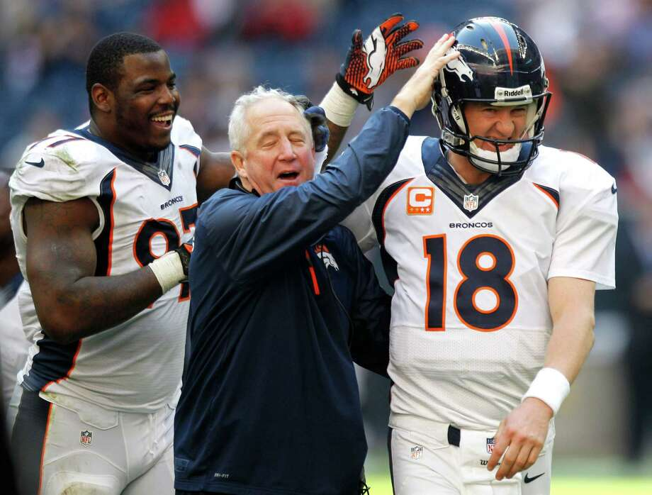 Broncos defensive end Malik Jackson (97) and head coach John Fox were among those congratulating quarterback Peyton Manning (18) for throwing his NFL single-season-record 51st touchdown pass. Photo: Brett Coomer, Staff / © 2013  Houston Chronicle