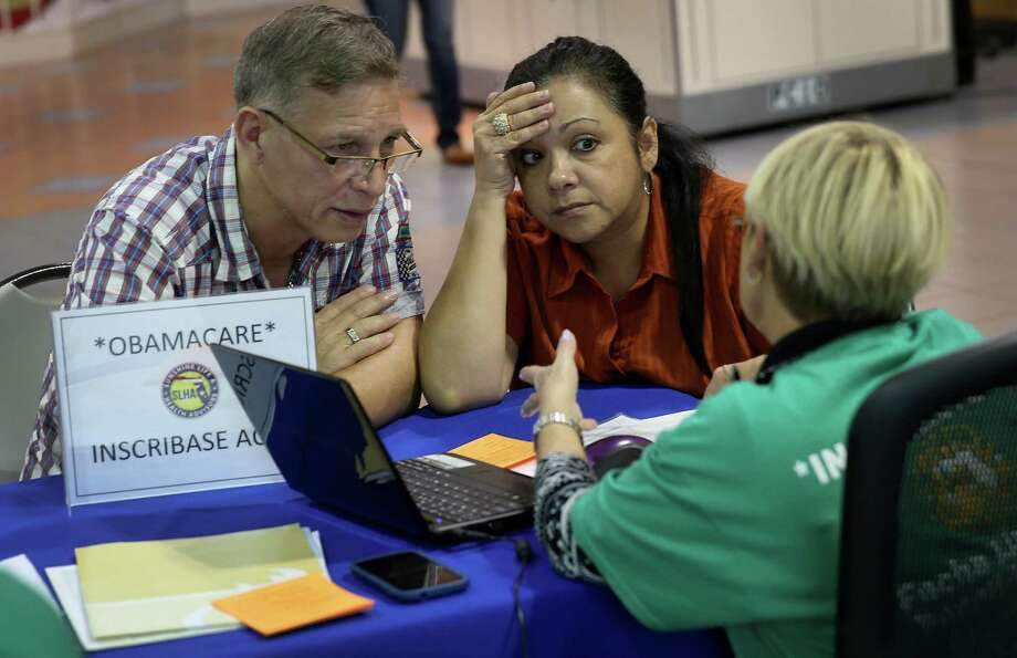 A couple try to purchase health insurance under the Affordable Care Act in Miami. Monday is the deadline for people to sign up if they want their new health benefits to kick in Jan. 1. Photo: Joe Raedle / Getty Images / 2013 Getty Images
