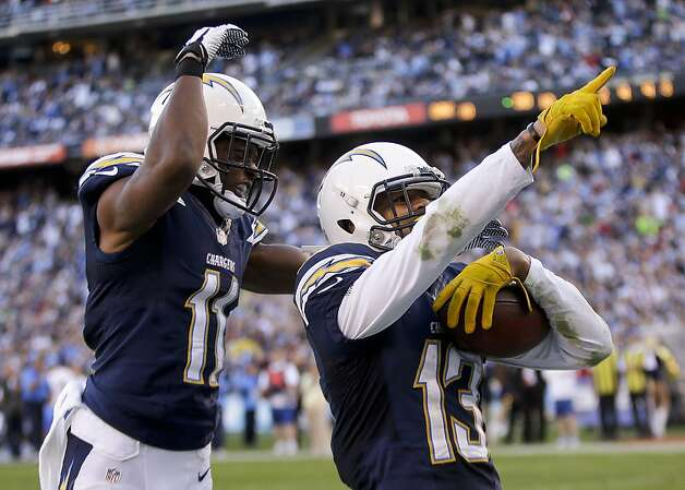 Keenan Allen (right) celebrates his third-quarter touchdown with Ed