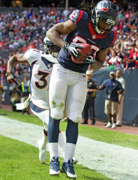 Texans receiver Keshawn Martin (82) beats Broncos cornerback Omar Bolden for a 15-yard touchdown reception. Photo: Brett Coomer, Staff / © 2013  Houston Chronicle
