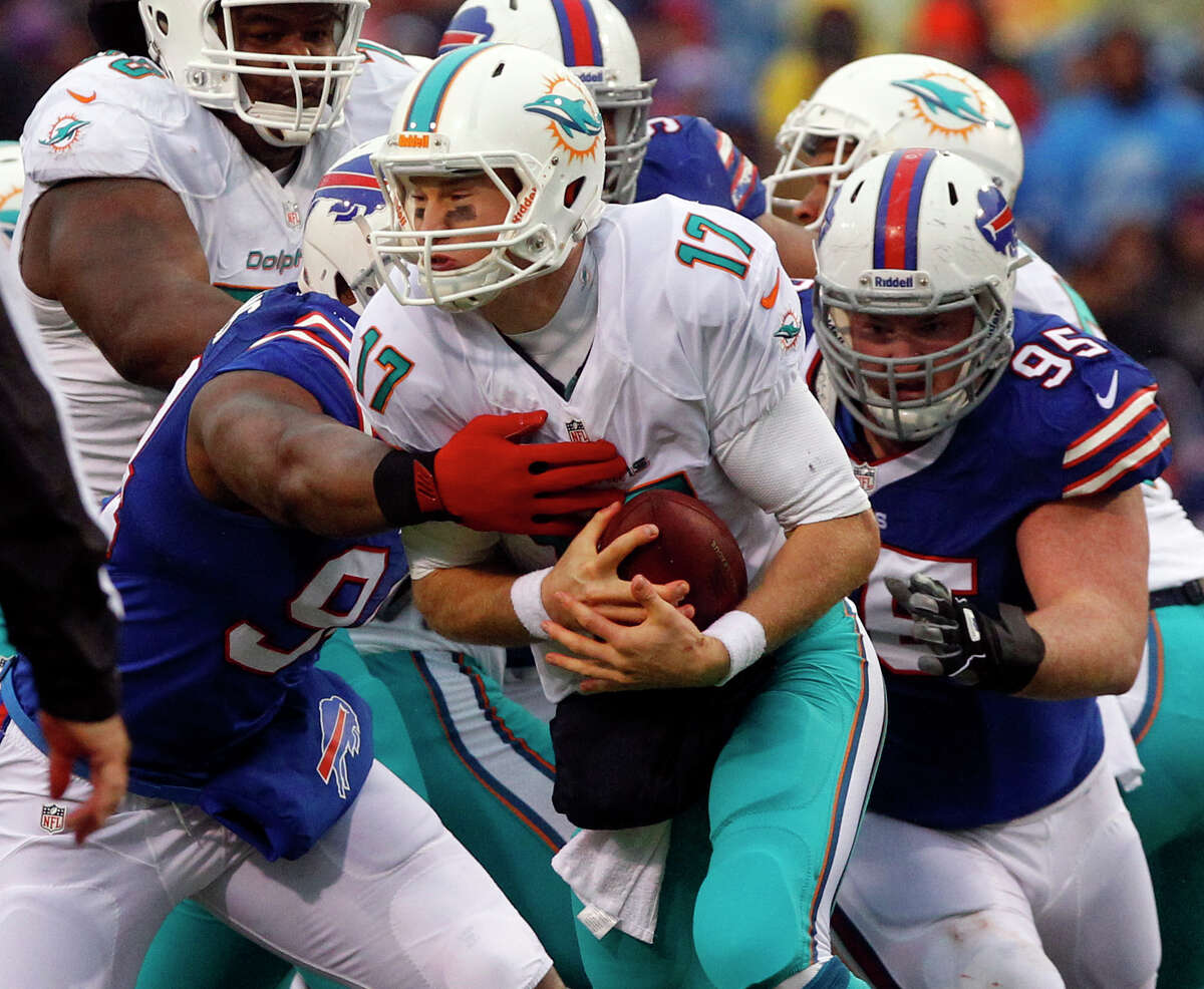 Miami Dolphins quarterback Ryan Tannehill (17) is sacked by Buffalo Bills defensive end Mario Williams (94) and defensive tackle Kyle Williams (95) during the first half of an NFL football game on Sunday, Dec. 22, 2013, in Orchard Park, N.Y. (AP Photo/Bill Wippert) ORG XMIT: otk