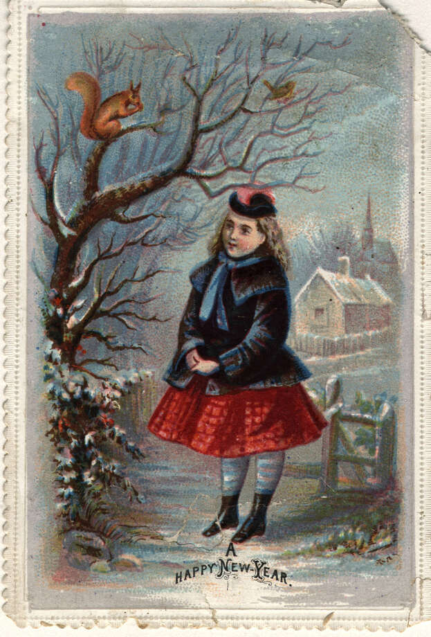A girl watches a red squirrel in a tree on this Victorian New Year's greetings card, circa 1875. Photo: Hulton Archive, Getty Images / Hulton Archive