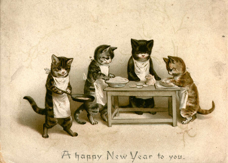Kittens cook a rat pie on a New Year's greetings card from  Raphael Tuck & Sons, circa 1880. Photo: Hulton Archive, Getty Images / Hulton Archive
