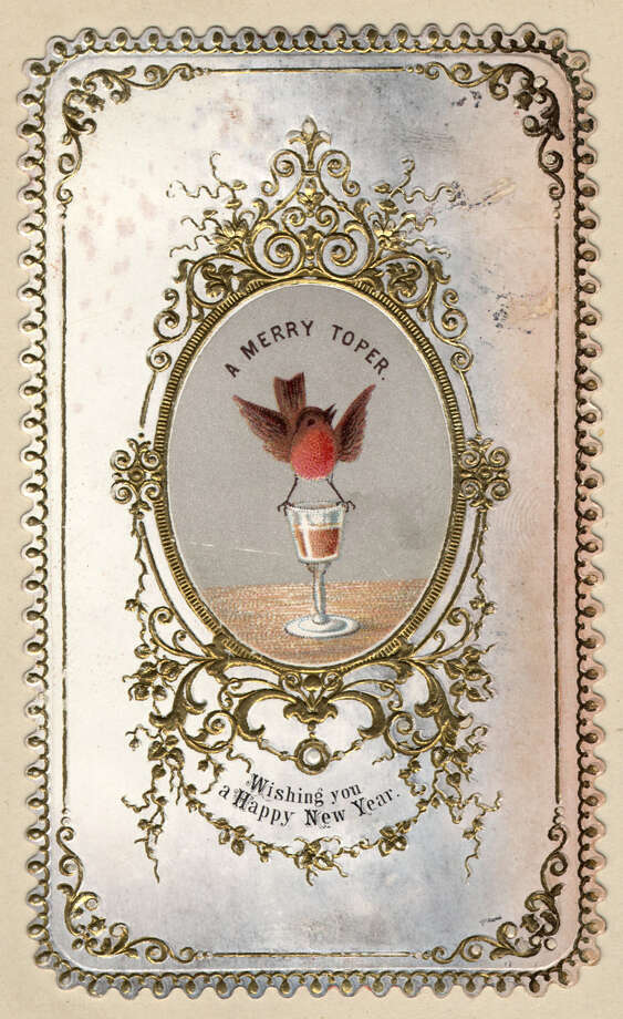 "A robin wishes the recipient of this New Year's greetings card a ""Merry Toper,"" or a good drink, circa 1871. Photo: Hulton Archive, Getty Images / Hulton Archive"