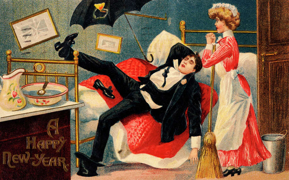 A vintage color illustration on New Year's Day features a maid with a broom finding her employer passed out on his bed in full evening dress, circa 1900. Photo: Popperfoto, Getty Images / Popperfoto