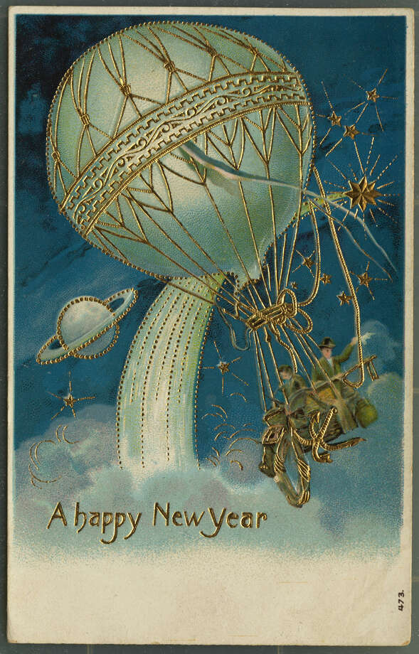 "A postcard of a hot air balloon in space wishes a ""Happy New Year,"" circa 1911. Photo: UniversalImagesGroup, Getty Images / Universal Images Group Editorial"
