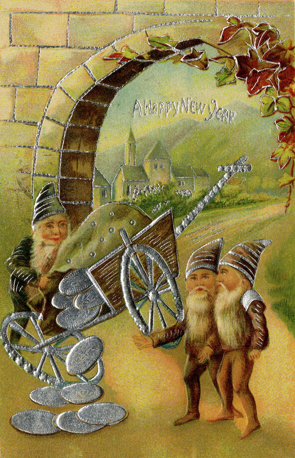 This silver-foil embossed New Year's greeting card depicts a trio of elves with a cart that overflows with silver coins, early 20th century. Photo: Buyenlarge, Getty Images / Archive Photos